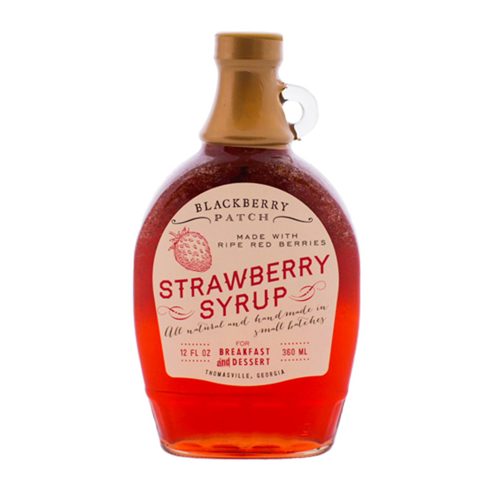 12oz glass jar of Blackberry Patch Classic Strawberry Syrup with pour handle.