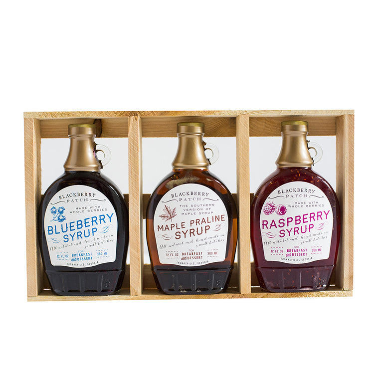 3 12oz jars of Blackberry Patch Classic Syrup in a wooden gift crate.