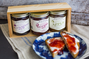 Photo of strawberry jam in use on toast.