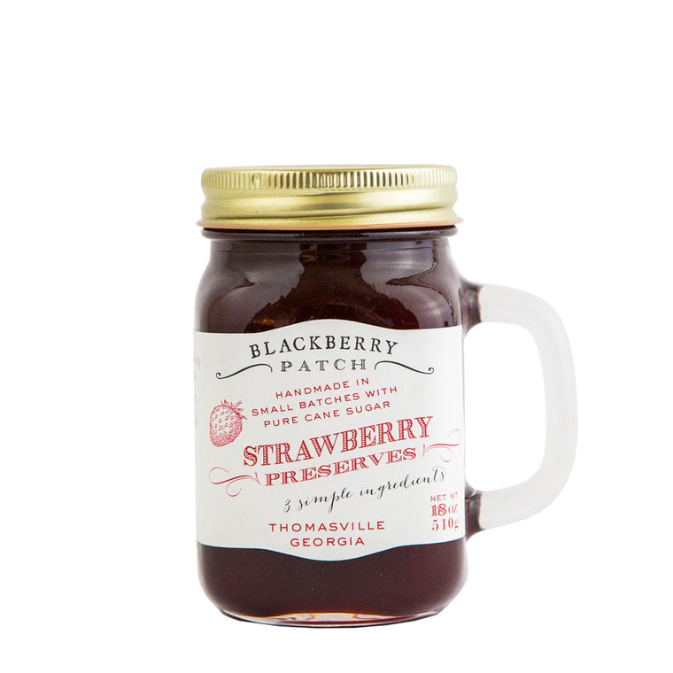 19oz jar of Blackberry Patch Strawberry Preserves. Jar is a handled mug with gold screw top.
