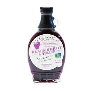 8oz glass jar of Blackberry Patch Premium Blackberry Syrup with pour handle. 3 Simple Ingredients.