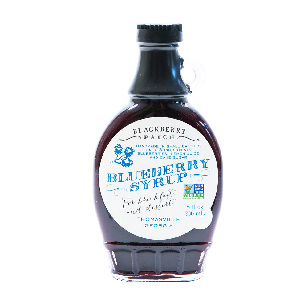 8oz glass jar of Blackberry Patch Premium Blueberry Syrup with pour handle. 3 Simple Ingredients.