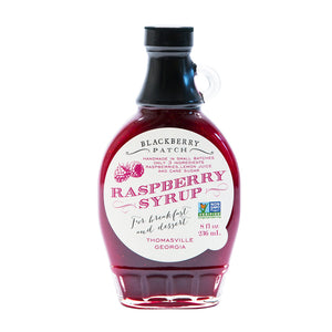 8oz glass jar of Blackberry Patch Premium Raspberry Syrup with pour handle. 3 Simple Ingredients.