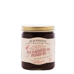 10oz glass jar of Blackberry Patch Old Fashioned Fig Preserves with gold screw on lid.