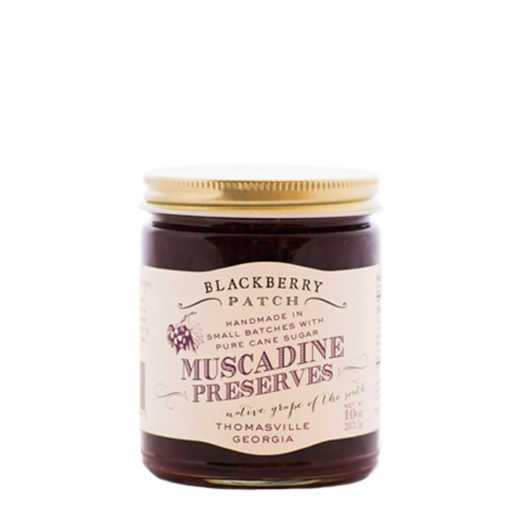10oz jar of Blackberry Patch Muscadine Preserves with gold screw on lid.