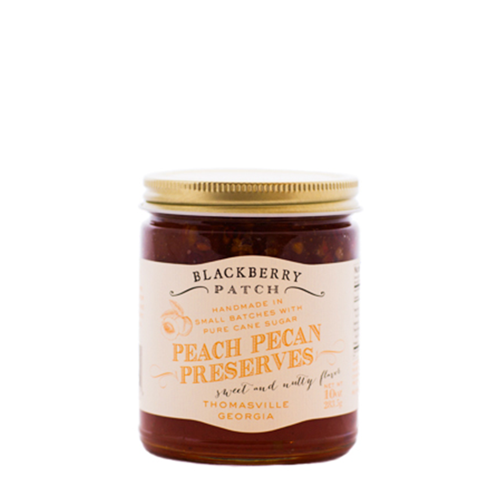 10oz glass jar of Blackberry Patch Peach Pecan Preserves with gold screw on lid.