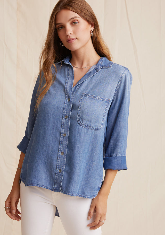 Front View: Womens Medium Wash Denim Long Sleeve Button Front Shirt With Chest Pocket and Collared Neckline