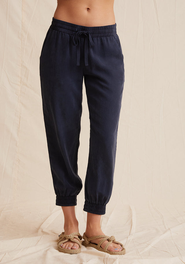 Front View: Womens Navy Blue Jogger Pant With Elasticized Waist and Side Seam Pockets.