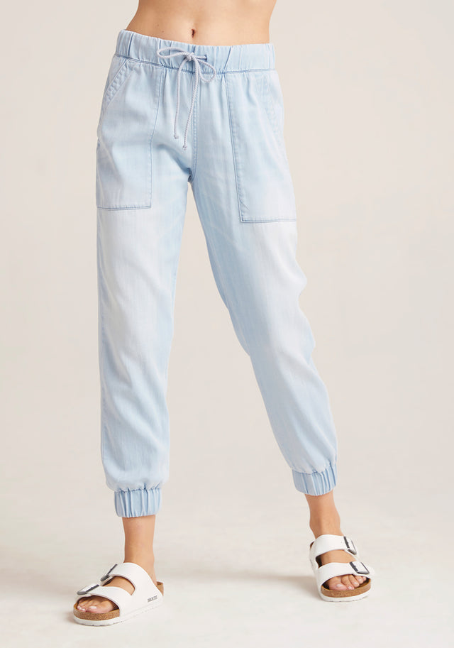 Front View: Womens Light Denim Wash Jogger Pant With Front Pockets and Cuffed Ankles