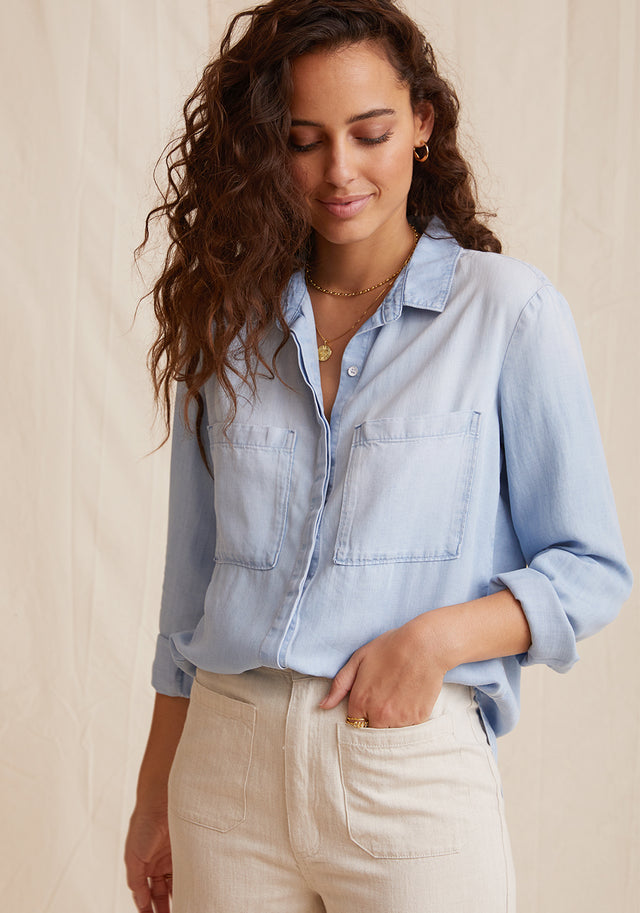 Front View: Womens Light Denim Wash Long Sleeve Button Down Shirt With Chest Pockets and Collared Neckline