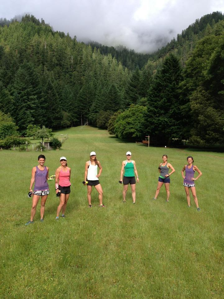 Runners in a meadow near the Rogue River Oregon
