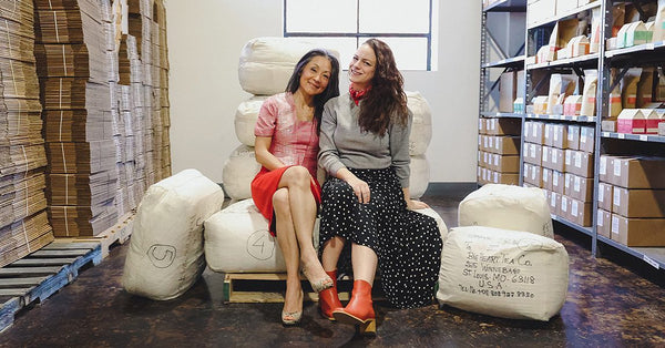 Kunthearath Nhek-Morrissey, VP Operations (left) and Lisa Govro, Founder (right) sitting in the Big Heart Tea Warehouse