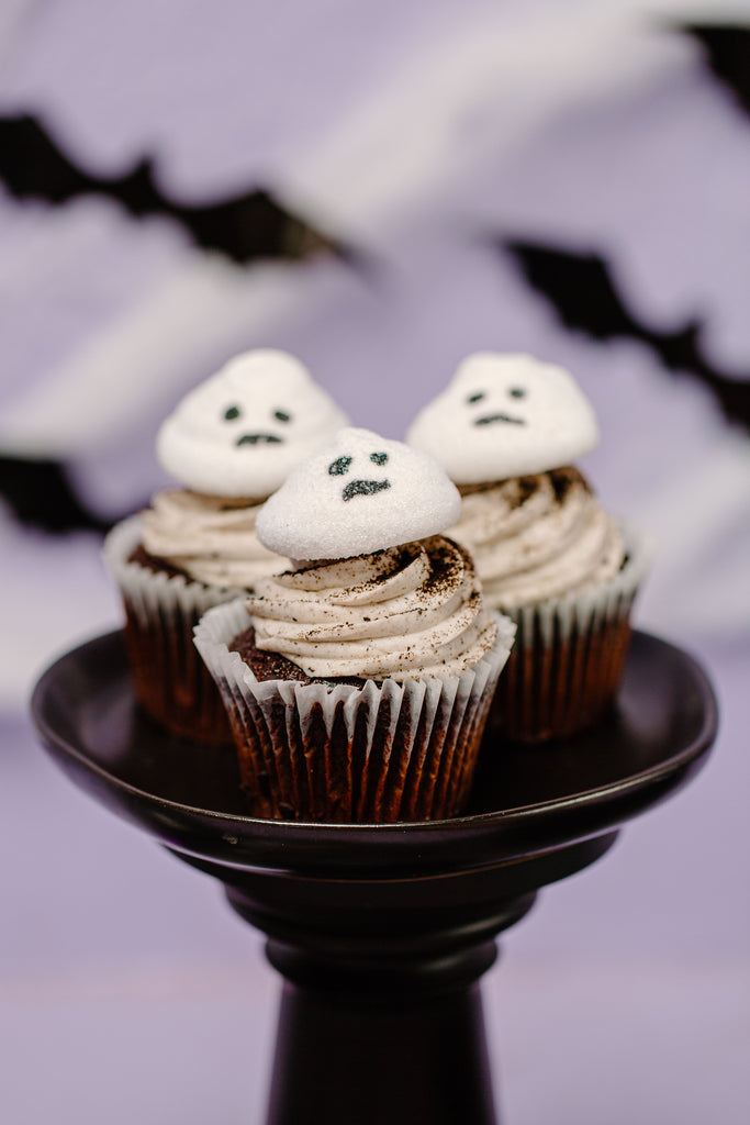 Boo Thang Marshmallow Ghosts on top of cupcakes