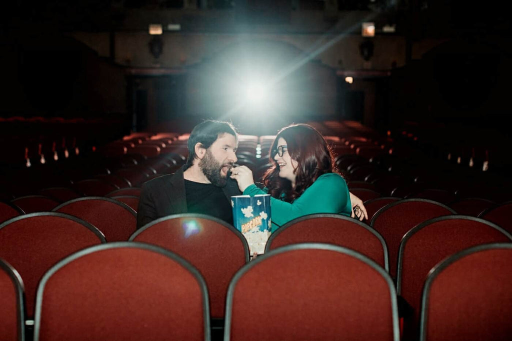Kat Connor and her fiancé, Nick, enjoy popcorn in their favorite Chicago movie theatre, The Music Box