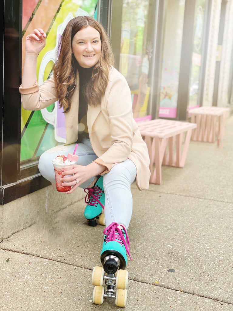 XO Marshmallow co founder, Lindzi Shanks, drinks a frozen Strawberry Shorty drink while wearing roller skates