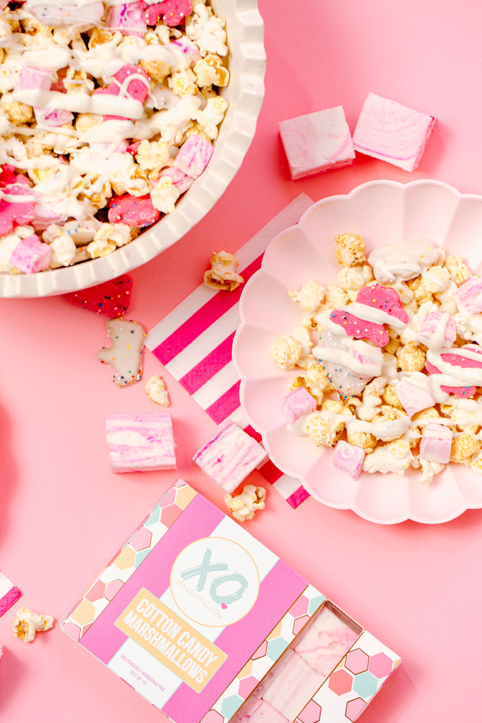 Cotton Candy Marshmallows, Frosted Animal Crackers, popcorn, white chocolate melted/drizzled on top