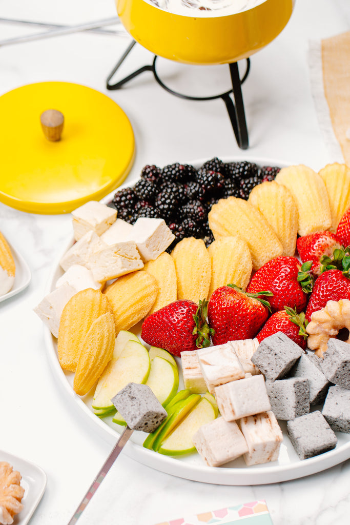 """The board of """"dippables"""" for the fondue party includes XO marshmallow, cookies, fruit, donuts and more"""