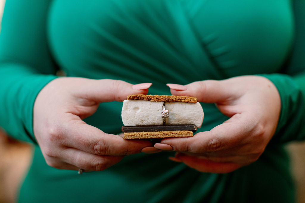 Kat Connor holds a s'more with her engagement ring inside