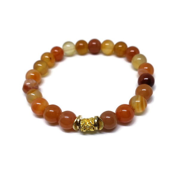 8 mm Natural Carnelian stretch bracelet with gold plated tube and spacers