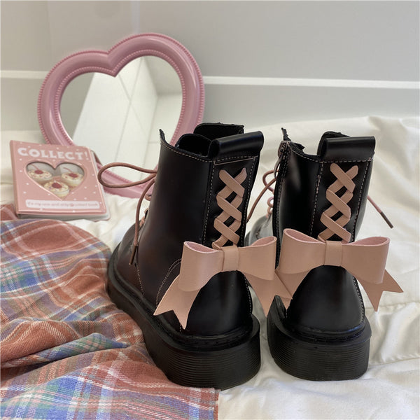 Pink bow Martin boots yv43609