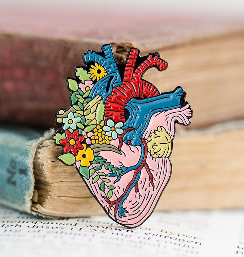 heart anatomy pin with flowers by codex anatomicus