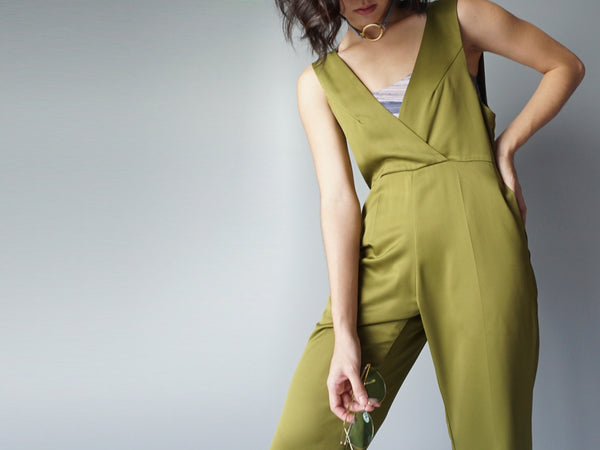 Olive pocketed vneck silk jumpsuit poster