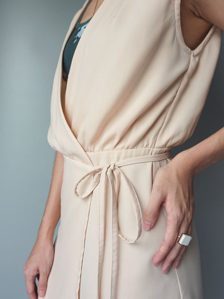 Almond wrap around drawstring dress side view