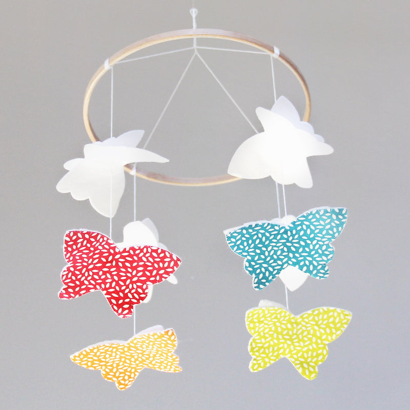 DEVELOPMENTAL BUTTERFLY BABY MOBILE WITH SWAPPABLE TUMMIES