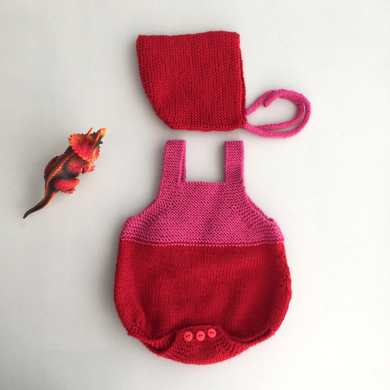 Hand knitted newborn romper and bonnet set in red & pink