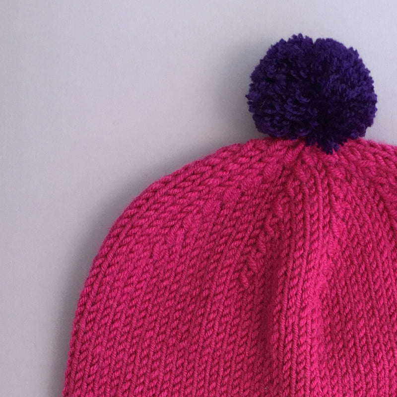 Hand knitted baby hat in pink & purple, size 0-12 months
