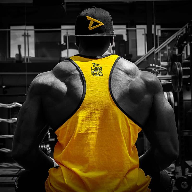 Dedicated Stringer (Yellow Back) Dedicated Logo