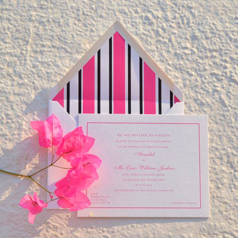 Thick 750gsm wedding invitation printed with pink text onto a thick