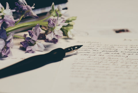 A fountain pen and written letter
