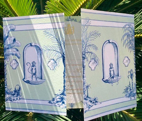 A beautifully illustrated gatefold wedding invitation, with gold foiled text on the inside
