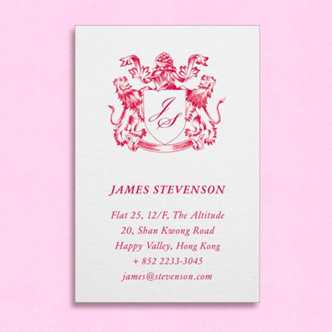 a portrait visiting card showing a family crest at the head and personal details below