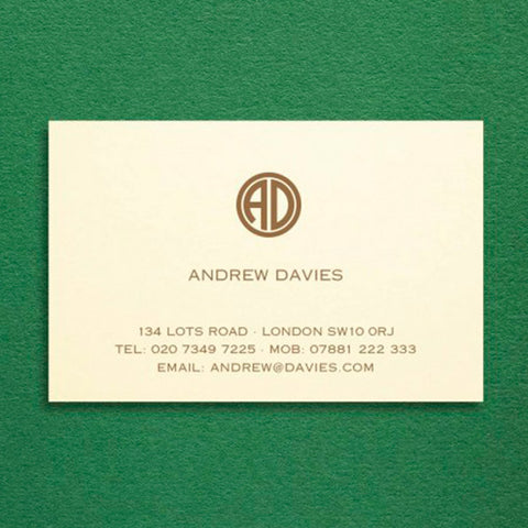 a cream visiting card showcasing a modern style monogram set of initials printed in brown