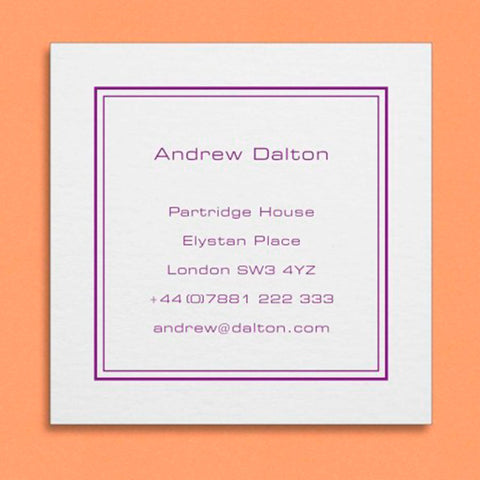 a square visiting card with an inset border and centred text