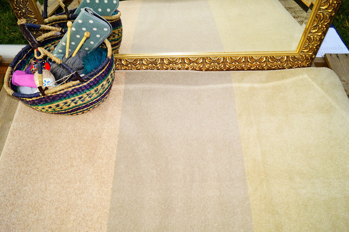 Beige and yellow striped rug.