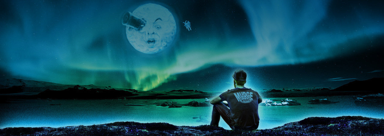 Mudge Staring at Whimsical Full Moon and Astronaut Under Northern Lights in the Distant Yonder.