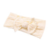 Image of Alicia Nylon Pom Pom Headband - Cream