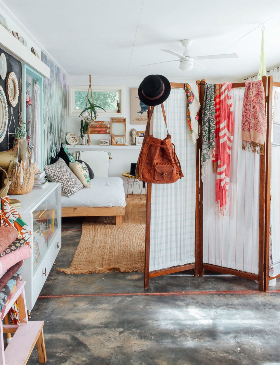 bohemian wander inspired home filled with travel mementos and a room divider screen