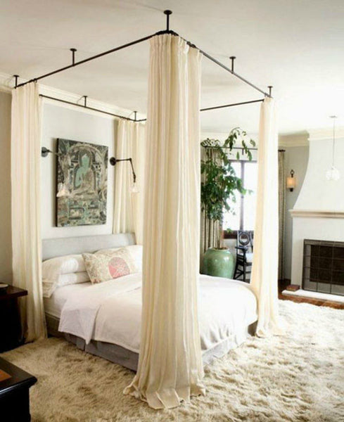 Ceiling mounted curtain rods for beds