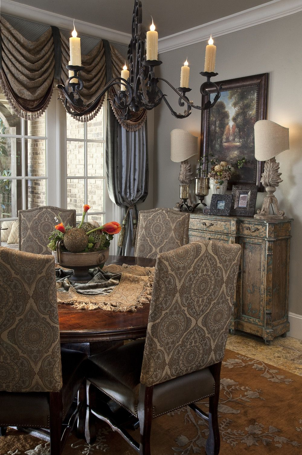 classic drapery in a traditional dining room with wrought iron chandelier