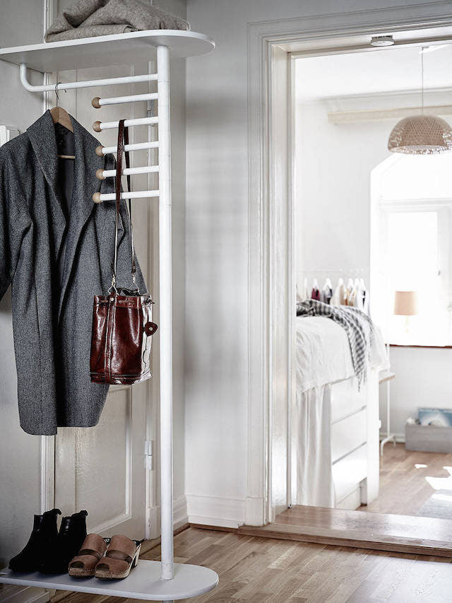 clothes hanger as small room divider in a tiny studio apartment