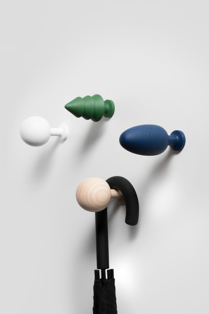 colorful curtain finials as wall hooks