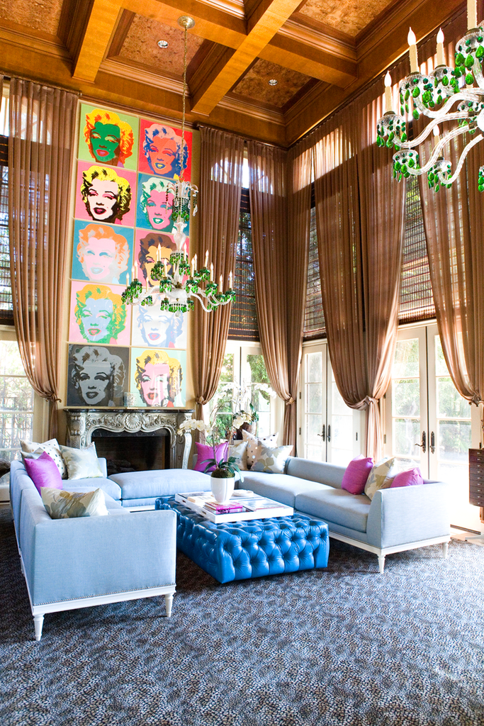 eclectic living room with green chandelier and opulent curtain finishes