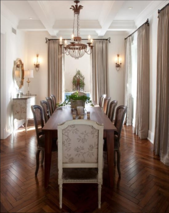 elegant dining room with wood floor formal seating and wrought iron finishes
