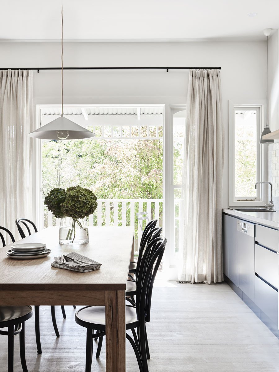 light linen curtains in a contemporary dining room