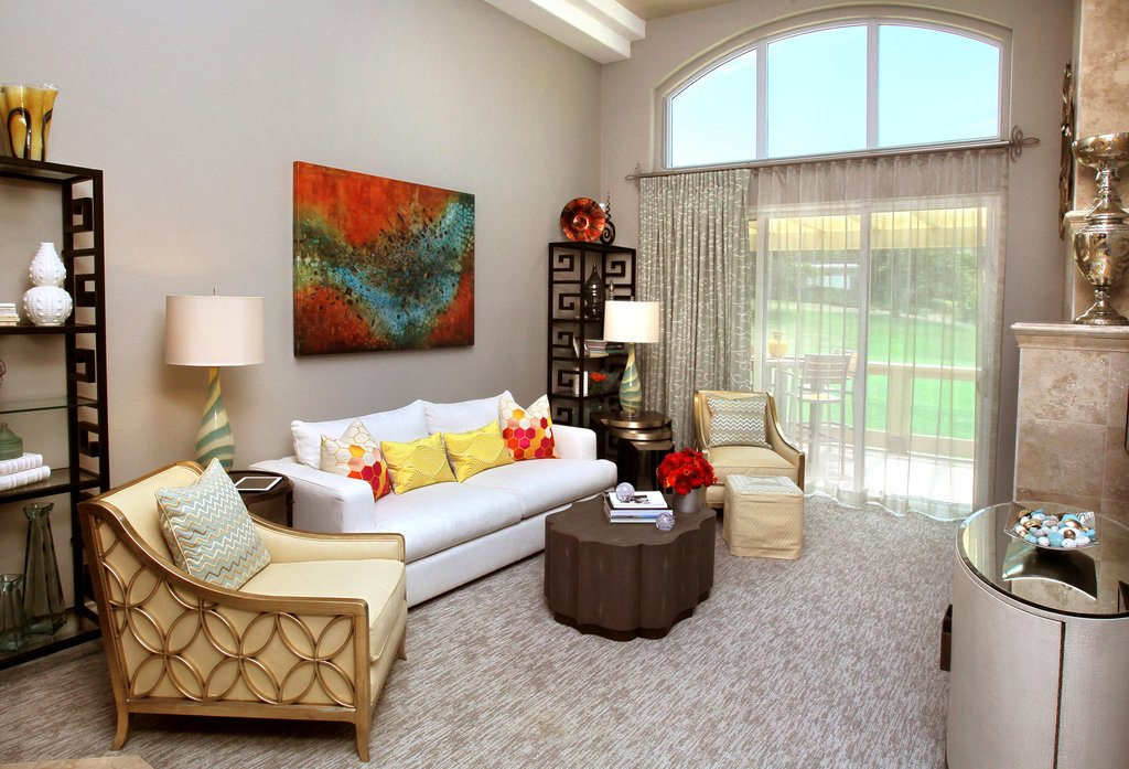 living room with modern art gold finishes and detailed curtain finials by helser brothers