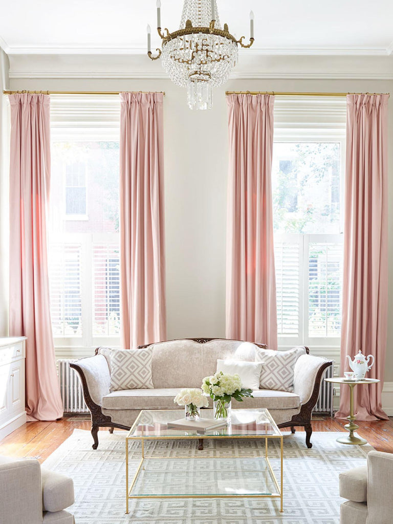 pink curtains in a light opulent living room